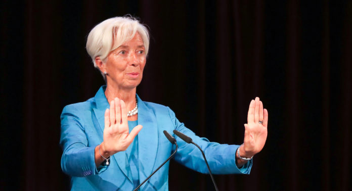 FILED - 31 August 2019, Saxony, Leipzig: President nominee of the European Central Bank (ECB) Christine Lagarde delivers a speech at a ceremony to award an honorary doctorate to the German Chancellor Angela Merkel. Lagarde, the nominee to succeed European Central Bank (ECB) President Mario Draghi, said the institution should continue its policies aimed at bolstering inflation but must be mindful of potential side-effects. Photo: Jan Woitas/dpa-Zentralbild/dpa